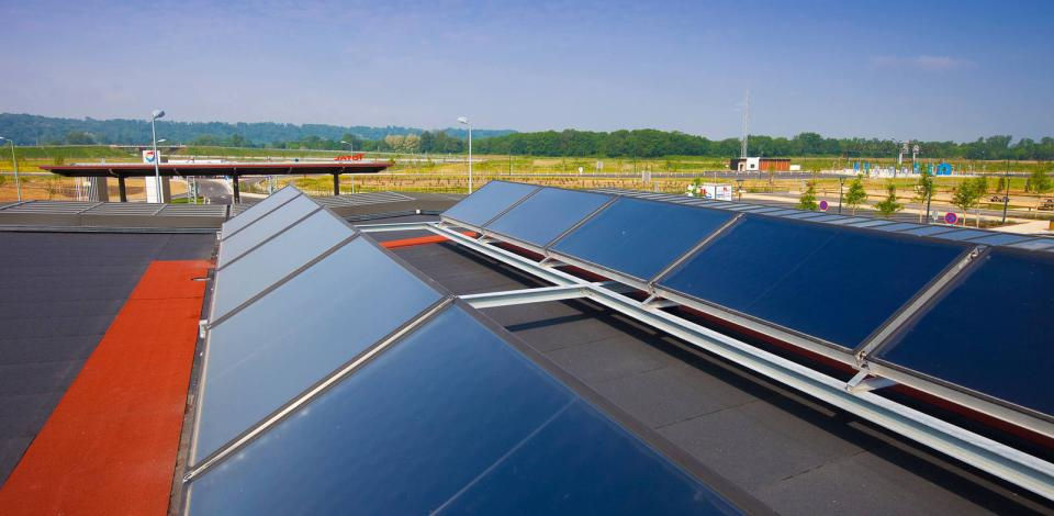 Rooftop panels on Relais de l'Adour and carport-top solar panels at a TotalEnergies  service station, France.