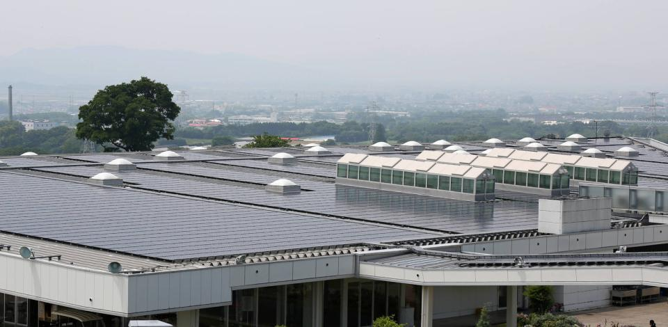 Installing SunPower (Total) solar panels on the roof at Sasyunkan co, Kumamoto, Japan.